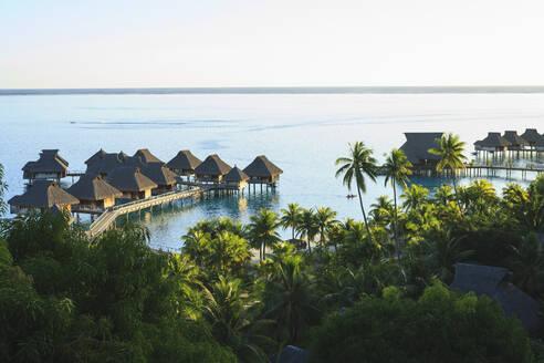 Palm trees overlooking tropical resort, Bora Bora, French Polynesia - MINF12237
