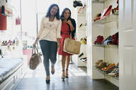 Women shopping together in shoe store - BLEF06811