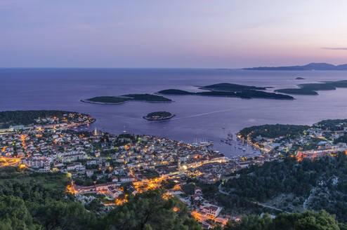 Aerial view of coastal town illuminated at night - MINF12313