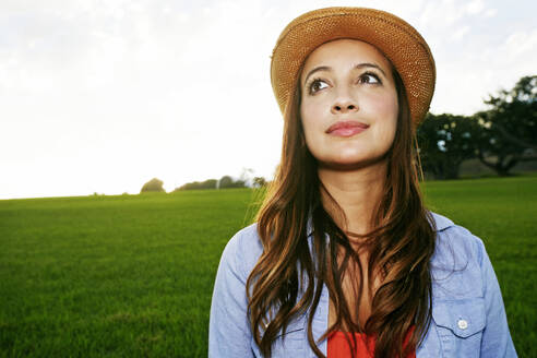 Hispanic woman smiling in grassy field - BLEF06847
