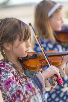 Close up of girls playing violin - BLEF06952