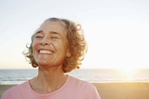 Caucasian woman smiling at beach - BLEF06979