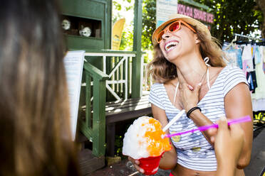 Laughing woman eating shaved ice - BLEF06985