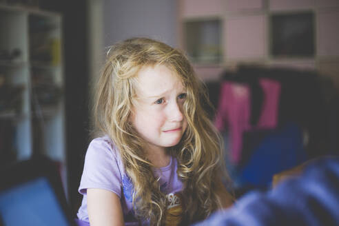 Portrait of a crying girl at home - IHF00108