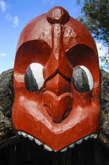 Traditional wood carved mask in the Te Puia Maori Cultural Center, Rotorua, North Island, New Zealand - RUN02704