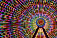 Spinning ferris wheel illuminated at night - MINF12480
