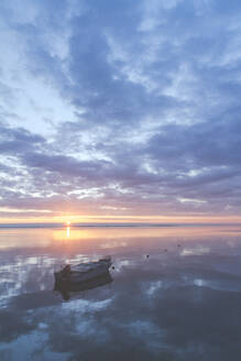 Boat on the Baltic Sea at a sunrise, Curonian Spit, Lithuania - IHF00129