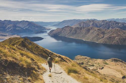 Man hiking at Roys Peak, Lake Wanaka, New Zealand - IHF00132