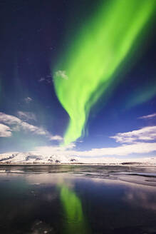 Northern lights reflecting in still remote river - MINF12572
