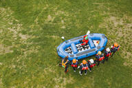 Top view of instructor talking to group of friends at a rafting class - FBAF00708