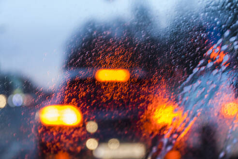 View through windscreen on rainy evening - TCF06090