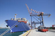 Container ship moored at commercial dock - JUIF01518