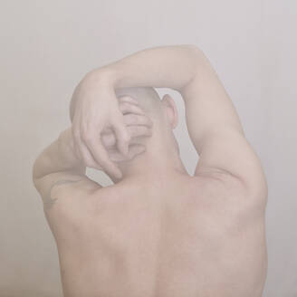 Caucasian man clutching his head - BLEF07295