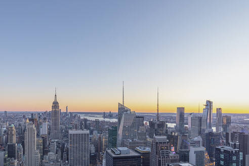 Skyline at sunset with Empire State Building in foreground and One World Trade Center in background, Manhattan, New York City, USA - MMAF01011