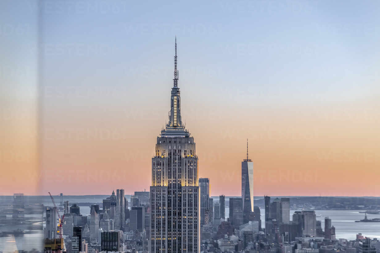 Skyline At Sunset With Empire State Building In Foreground And One World Trade Center In Background