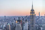 Skyline at sunset with Empire State Building in foreground and One World Trade Center in background, Manhattan, New York City, USA - MMAF01020