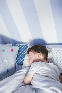 Little boy sleeping on bed in the morning - LJF00136
