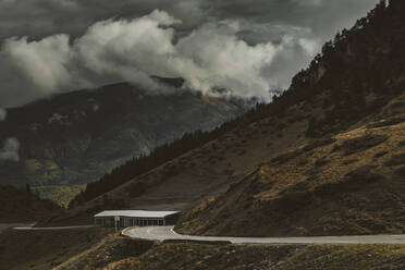 Dramatic landscape of storm clouds and road on Midi-Pyrenees, France - OCAF00423
