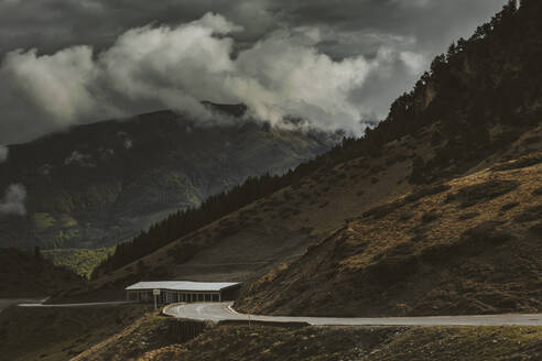 Dramatic landscape of storm clouds and road on Midy Pyrenees - OCAF00423