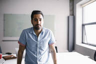 Portrait confident businessman in office - HEROF36712