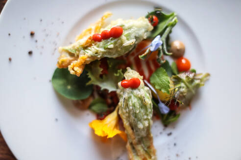 Exotic dish of salad leaves and flowers - ISF21633