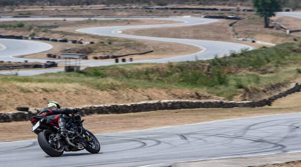 Biker riding motorcycle on race track, Kaeng Krachan, Phetchaburi, Thailand - ISF21684