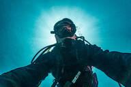 Diver taking selfie, Ko Racha Yai, Rawai, Phuket, Thailand - ISF21693