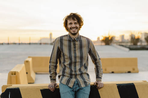 Portrait of laughing man during sunset, Barcelona, Spain - AFVF03325