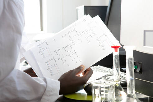 Young female scientist looking at results in laboratory, cropped - CUF51562