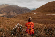 Woman enjoying view of scenic landscape, Queenstown, Canterbury, New Zealand - ISF21821