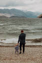 Father and baby on beach, Queenstown, Canterbury, New Zealand - ISF21824