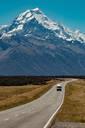 Scenic view of rural road leading towards mountains, Wanaka, Taranaki, New Zealand - ISF21839
