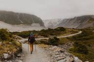 Hiker exploring trail, Wanaka, Taranaki, New Zealand - ISF21860