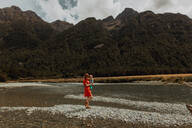 Mother and baby exploring lake, Queenstown, Canterbury, New Zealand - ISF21887