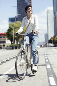 Woman with bike on bicycle lane - JSRF00348