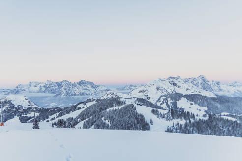 View over snowy mountains at dusk, Saalbach Hinterglemm, Pinzgau, Austria - MMAF01066