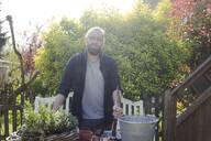 Portrait of man gardening - MOEF02280