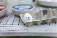 Close-up of decorated Easter egg on garden table - MOEF02292