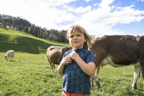 Girl with cows on pasture - FBAF00826