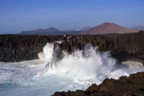 Breaking waves at rocky coast, Los Hervideros, Lanzarote, Spain - SIEF08714