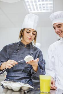 Junior chefs prepairing a dessert - LJF00172
