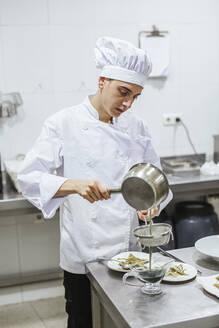 Junior chefs prepairing a dessert - LJF00202