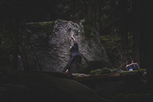 Climber bouldering, watched by friend, Squamish, Canada - ISF21926