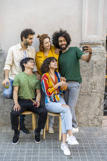 Man taking a selfie with friends in the city - AFVF03551