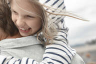 Close-up of happy daughter in her father's arms - EYAF00269