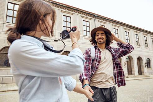 Young tourist couple walking in courtyard of Munich Residenz, Munich, Germany - SUF00588
