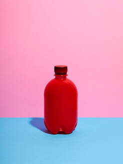 Still life with red plastic bottle and pink background - CUF52533