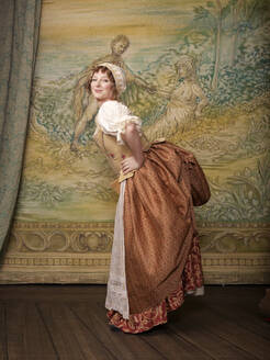 Actress dressed in old-fashioned costume on stage - BLEF07832