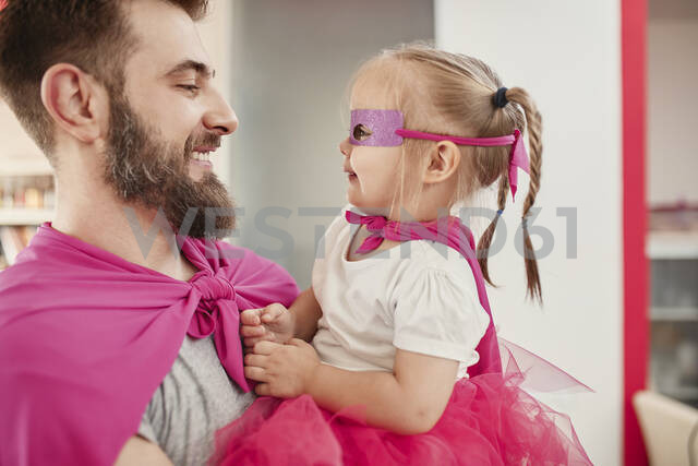 Father and daughter playing super hero and superwoman - ZEDF02507