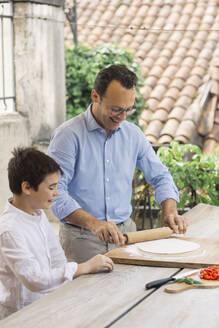 Father and son preparing pizza together - ALBF00915